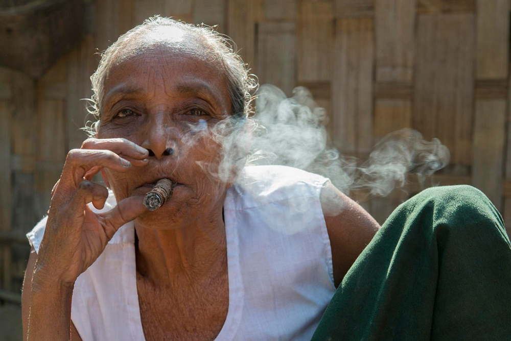 A Marma lady smoking churut