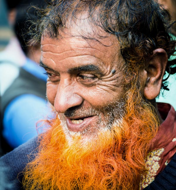 Man with orange beard in Bangladesh.