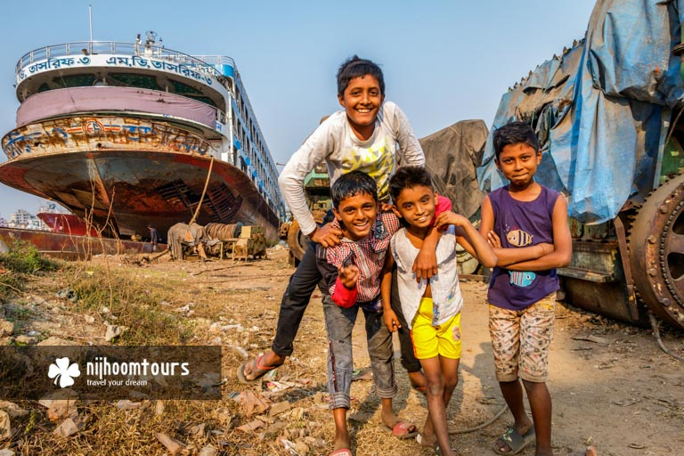Photo of some happy kids of Dhaka Shipyards - one of the best places to visit in Dhaka City for photography