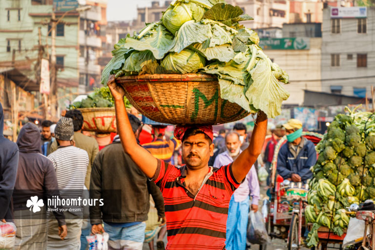 A photo of a porter at Kawran Bazar, one of the best places to visit in Dhaka City