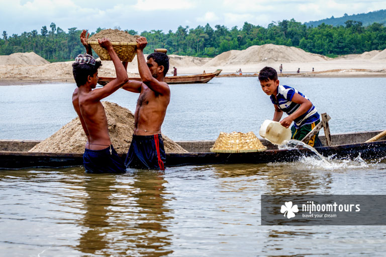 People collecting sand from the riverbed in Jaflong - number eight among the best places to visit in Bangladesh